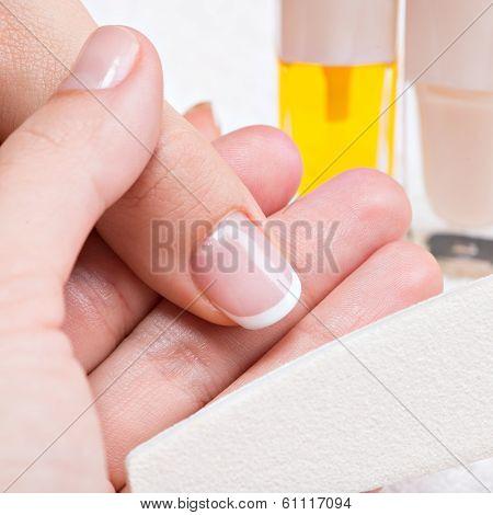Beautician Applying Nail Varnish On A Thumbnail.