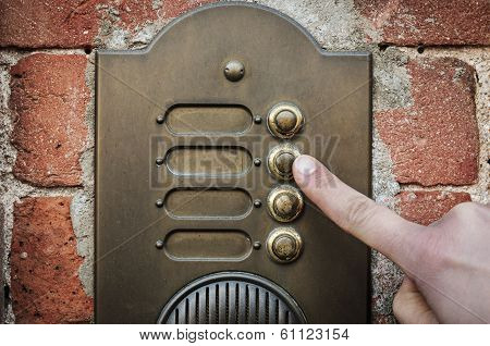 Finger ringing a door bell