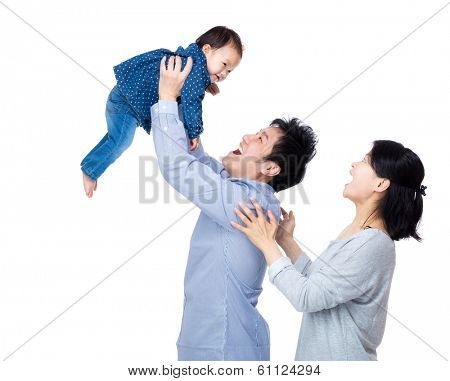 Asia father throw his baby up with smile wife