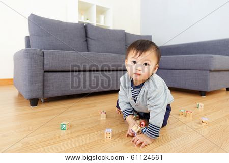 Aisa baby boy play toy block at home