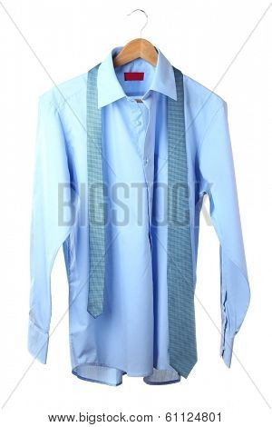 Blue shirt and tie on wooden hanger isolated on white