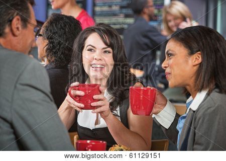 Smiling Female With Friends In Cafe