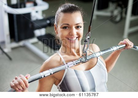 Young woman exercising back muscles
