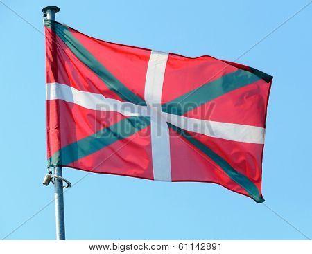 Basque country flag, blue sky background