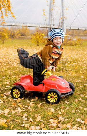 Cute Boy Playing With His Car Outdoor