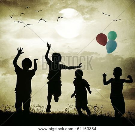 Retro old fashioned photo of children with balloons running on summer meadow