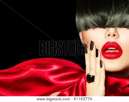 Sexy Model Woman Portrait over Black background. High Fashion Girl with Trendy Hair style, Make up and Manicure.