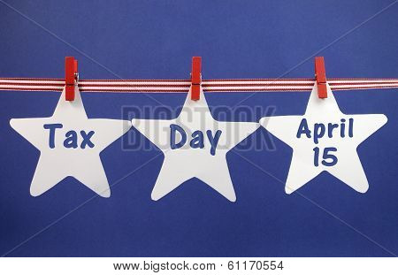 Tax Day April 15, For Usa Tax Day Reminder, Greeting Or Message Across White Stars Hanging From Pegs