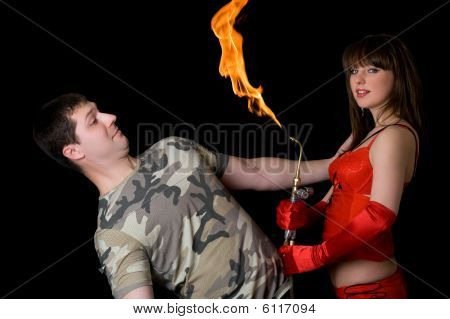 Young Woman With A Gas Torch And Scared Man. Isolated