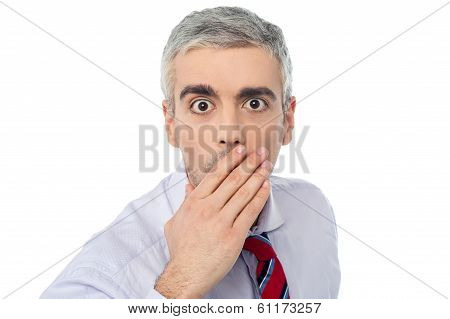 Senior Mature Man Closing Mouth With Hand
