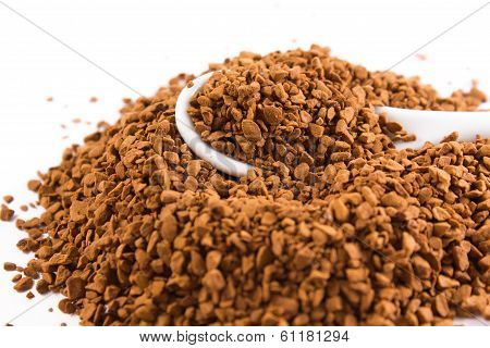Coffee Granules And A White Spoon