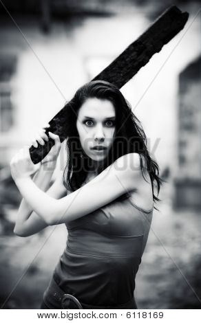 Young Danger Woman With Stick