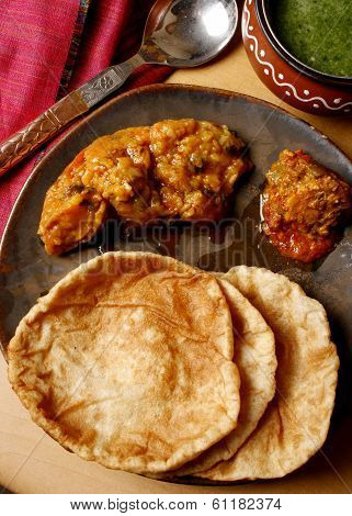 Khasta Puri - A Crumbly Fried Bread Of Refined Flour Flavoured With Carom Seeds