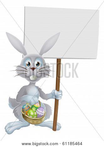 White Easter Rabbit Holding Sign