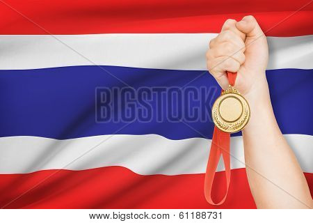 Medal In Hand With Flag On Background - Kingdom Of Thailand