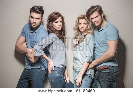fashion models in blue jeans and casual polo shirts posing in studio