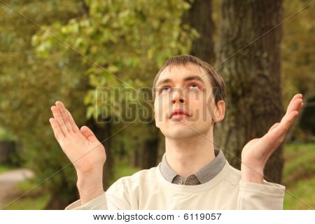 Young Man Prays Outdoor In Summer