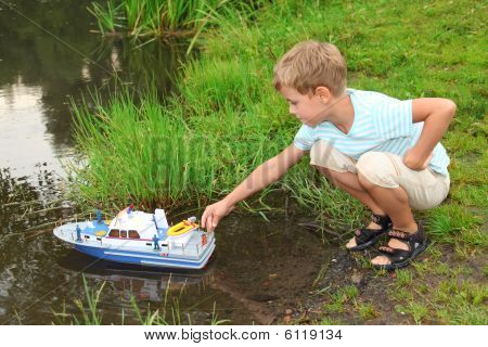Boy Sends Toy Ship In Floating