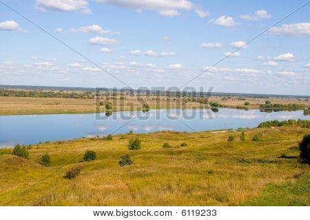 Beautiful River And Yellow Meadow