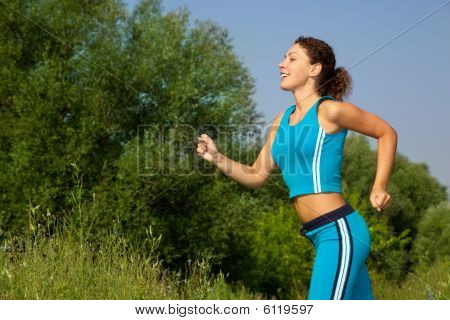 Young Attractive Woman Runs In The Country