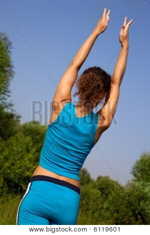 Woman Back During Fitness In The Country