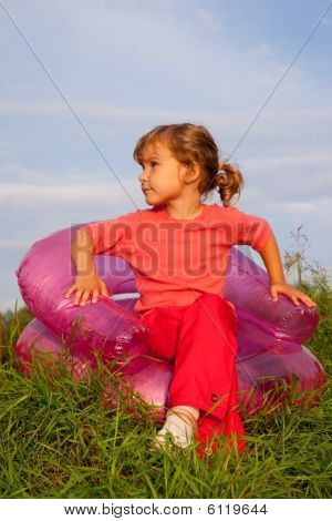 Girl Looking At The Sky In Inflatable Armchair