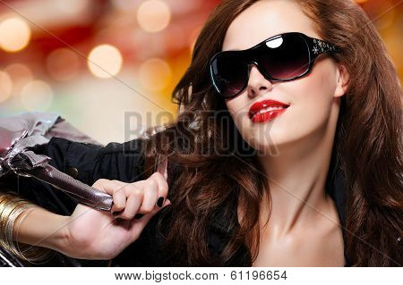 Fashion Woman In Black Trendy Sunglasses With Handbag