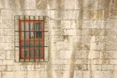 Window With Bars Of A Medieval Building poster
