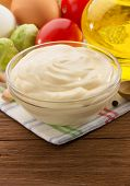 mayonnaise sauce in bowl on wooden background