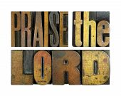 stock photo of preacher  - The words PRAISE THE LORD written in vintage letterpress type - JPG