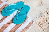 Blue flip flops at tropical beach