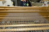 stock photo of loom  - This is how the threads in a loom is working - JPG