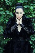 stock photo of evil queen  - Dark Queen in park - JPG