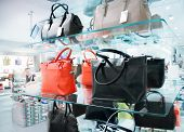 foto of exposition  - Shop window with female handbags and shoes - JPG