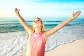foto of hands up  - Happy woman with hands up at sunrise time - JPG