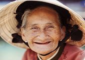 stock photo of toothless smile  - Close up face of beautiful smiling woman with wrinkles - JPG