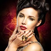 stock photo of minx  - Beautiful woman with golded nails and bright red lips - JPG