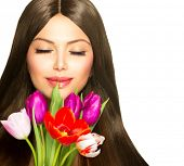 Beauty Woman with Spring Flower bouquet. Beautiful girl with a Bouquet of Tulip flowers.
