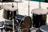picture of drum-kit  - Black drum kit on stage before concert - JPG