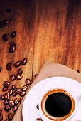 Coffee Cup And Roasted Coffee Beans  On Wooden  Brown Background With Copyspace For Text. Coffee  On