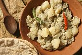 foto of bengali  - Aloo Posto is a delicious Bengali side dish generally eaten as a dry accompaniment to a meal of rice and curries - JPG