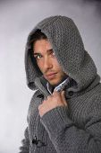 foto of hoodie  - Good looking young man wearing winter hoodie sweater looking at camera - JPG