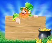 foto of cauldron  - St Patricks day leprechaun background with wooden sign and cauldron or pot of gold coins - JPG