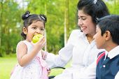 image of indian apple  - Happy Indian family - JPG