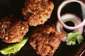 picture of kababs  - Kacche Kebab is made by Keema and besan adding egg. Roll the kababs holding the frying pan handle. Fry over moderate heat till kababs turn brown.Kacche kebab contains keema as major ingredient.