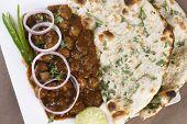 image of punjabi  - A popular Punjabi preparation of chick peas cooked in spicy tomato gravy - JPG