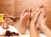 foto of foot massage  - Massage of human foot in spa salon - Soft focus image
