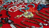 stock photo of flea  - vintage style jewelry and trinkets for sale at a flea market in Rome - JPG