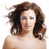 foto of blown-up  - Front view of beauty and sexy woman with blown hairs - JPG