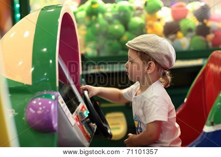 Boy Playing Arcade Game Machine